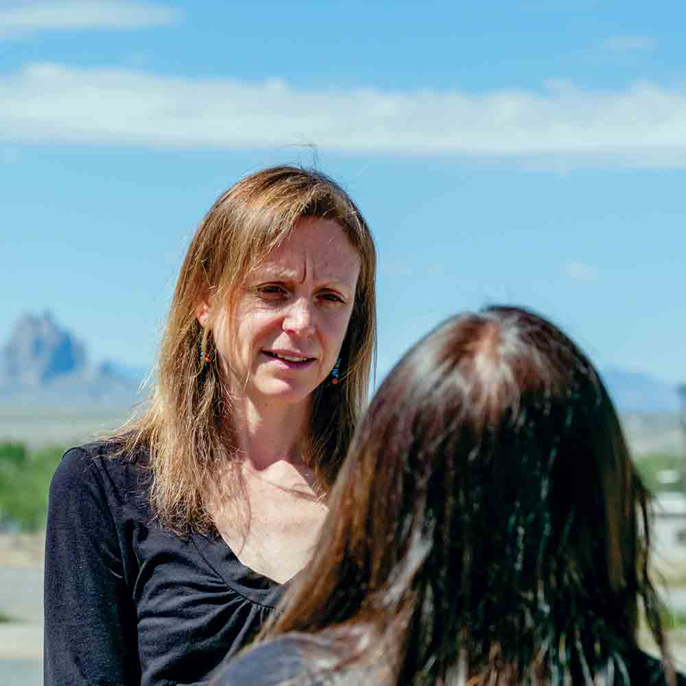 DNA People's Legal Services Attorney Heather Hoechst talks with a client in Shiprock, New Mexico.